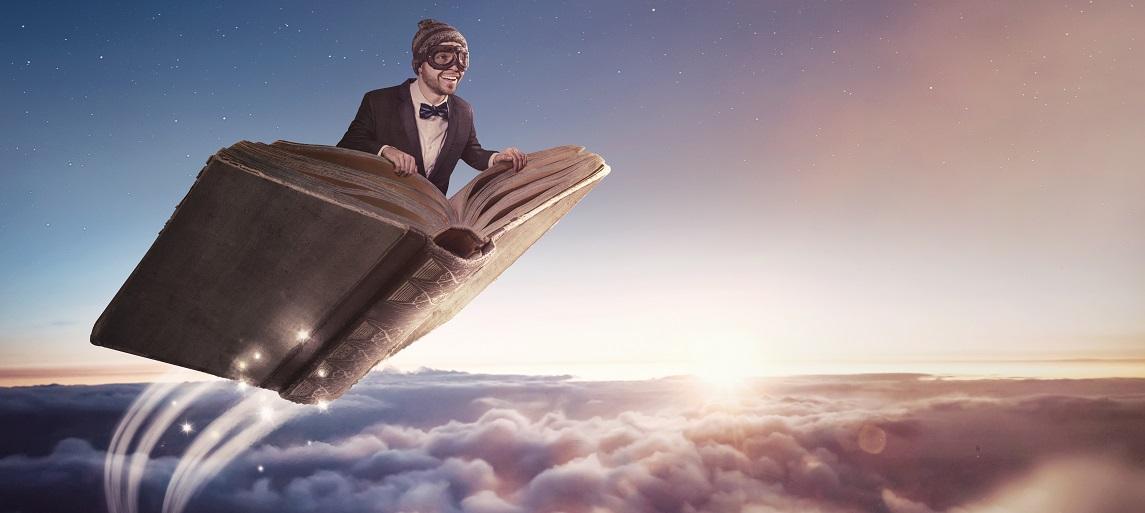homme sur un livre volant